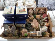A box of eight Little Light of Mine lighthouse ornaments together with a quantity of cottage