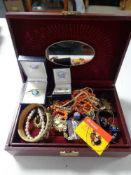 A leather jewellery box of necklaces, earrings,