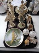 A tray of four Art Deco Italian figures on wooden stands, two wall plates,