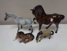 A Royal Doulton Brown gloss horse and foal together with two further horse figures (4)