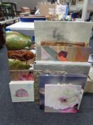 A large quantity of assorted prints, wall canvases,
