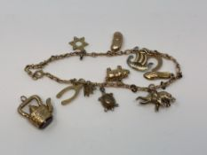 A 9ct gold charm bracelet and one loose charm CONDITION REPORT: 14.