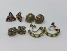 Four pairs of gold gem set earrings