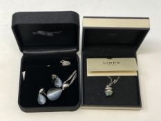 A Diamonfire silver pendant and matching earrings in box,