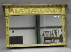 A Regency giltwood and gesso overmantel mirror, the ballshot mounted pediment above an anthemion and