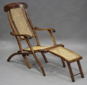 A late Victorian walnut framed folding steamer armchair with caned panels, height 90cm, width 55cm.