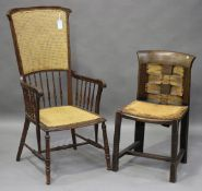 An Edwardian beech framed comb back elbow chair with caned seat and back panel, height 114cm,