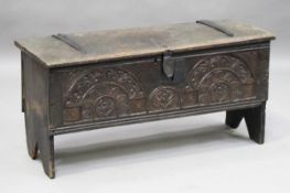 A 17th century and later oak six-plank coffer, the front later carved with bold lunettes, height