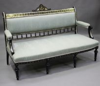 A late 19th century ebonized five-piece salon suite with mother-of-pearl and brass line inlaid