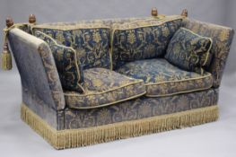 A modern Knole settee by Ashley Lawrence, upholstered in a gold and blue velour, fitted with beech