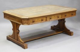 A late Victorian Gothic Revival oak library table by Bulstrode of Cambridge, the top inset with