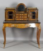 A late Victorian burr walnut and boxwood inlaid bonheur-du-jour with overall applied gilt metal