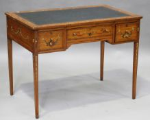 An Edwardian satinwood writing desk with overall painted floral decoration, the top inset with