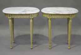 A pair of late 20th century Louis XVI style cream painted oval occasional tables, the white marble