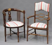 An Edwardian mahogany framed and boxwood inlaid elbow chair, upholstered in contemporary striped