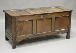 An early 18th century panelled oak coffer with channel moulded decoration, height 68cm, width 141cm,