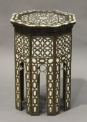 A 20th century Middle Eastern hardwood octagonal table, inlaid in mother-of-pearl and bone, height