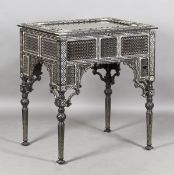 A late 19th century Middle Eastern ebonized bijouterie table, inset with overall panels of finely