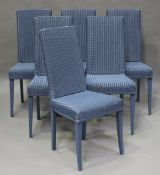 A set of six modern Lloyd Loom blue painted dining chairs, raised on square tapering legs, height