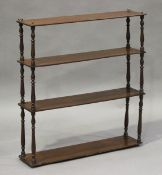 A Victorian mahogany four-tier wall shelf with turned spindle supports, height 71cm, width 65.5cm,