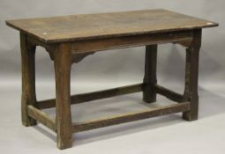 A 17th century and later oak refectory table, the cleated three-plank top on chamfered block legs