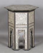 An early 20th century Middle Eastern hardwood and mother-of-pearl hexagonal occasional table,