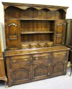 A 20th century Jacobean style oak dresser, the shelf back above drawers and cupboards, on stile