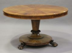 A mid-Victorian figured mahogany tip-top breakfast table, the radially-veneered top above a tapering
