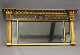 A 19th century Regency style gilt and ebonized overmantel mirror, the ballshot pediment above a