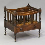 A Regency mahogany Canterbury, the four divisions with central pierced handle above a mahogany-lined