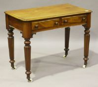 A Victorian mahogany side table, fitted with two frieze drawers, on reeded tapering legs and china