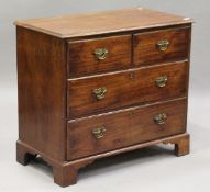 A George III mahogany chest of two short and two long drawers, height 81cm, width 91cm, depth 47.