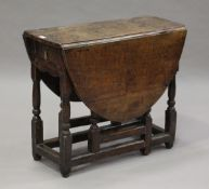 A small early 18th century oak oval gateleg table, fitted with a single drawer, height 65.5cm,