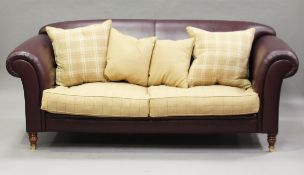 A modern maroon leather and chequered fabric settee, on turned legs and brass caps, height 85cm,