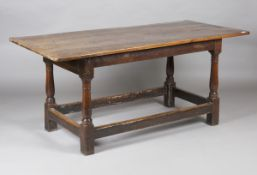 A mid-18th century provincial oak refectory table, the three-plank top above a single end drawer,
