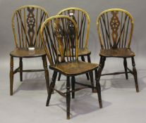 A harlequin set of four early Victorian ash and elm stick and wheel back Windsor dining chairs,