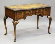 An early 20th century Queen Anne style walnut writing table, raised on carved cabriole legs,