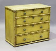 A Regency painted pine chest of four graduated long drawers with faux bamboo edging and black
