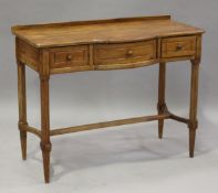 A late 19th century pine side table, fitted with three drawers, on chamfered legs, height 82cm,