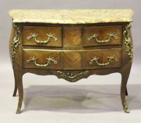 A 20th century Louis XV style kingwood and gilt metal mounted three-drawer commode with a serpentine