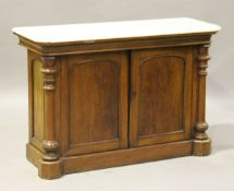 A late Victorian mahogany marble-topped side cabinet, fitted with two arched panel doors flanked
