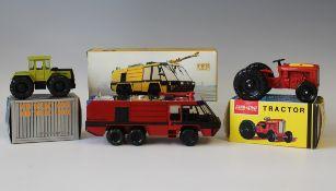 A Conrad No. 5501 Air Crash Fire Rescue vehicle, a Lone Star Farm King tractor and a Gescha MB