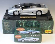 A Maisto 1/12th scale model of a Jaguar XJ220, finished in silver, and a Matchbox Masterclass