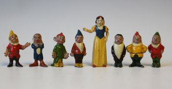 A Britains painted lead figure set No. 1654 Snow White and the Seven Dwarfs (paint chips), and a