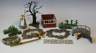 A collection of Britains plastic garden series items, including trees, fence panels, borders,
