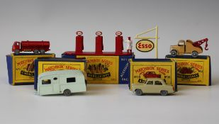 Four Moko Lesney Matchbox vehicles, comprising a No. 11A ERF road tanker, finished in red with
