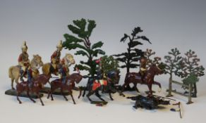 A collection of Britains and other lead military figures, cavalry, trees, two Elastolin Life
