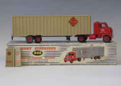 A Dinky Supertoys No. 948 tractor and trailer 'McLean', with red plastic hubs, boxed (some paint