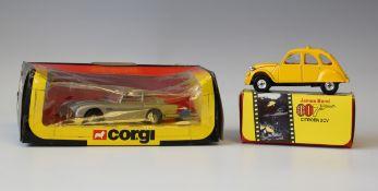 A Corgi No. 271 James Bond Aston Martin with two bandit figures, within a window box, and a Corgi