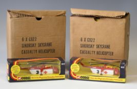 Twelve Corgi No. 922 Sikorsky Skycrane Casualty Helicopters, in window boxes within two shop
